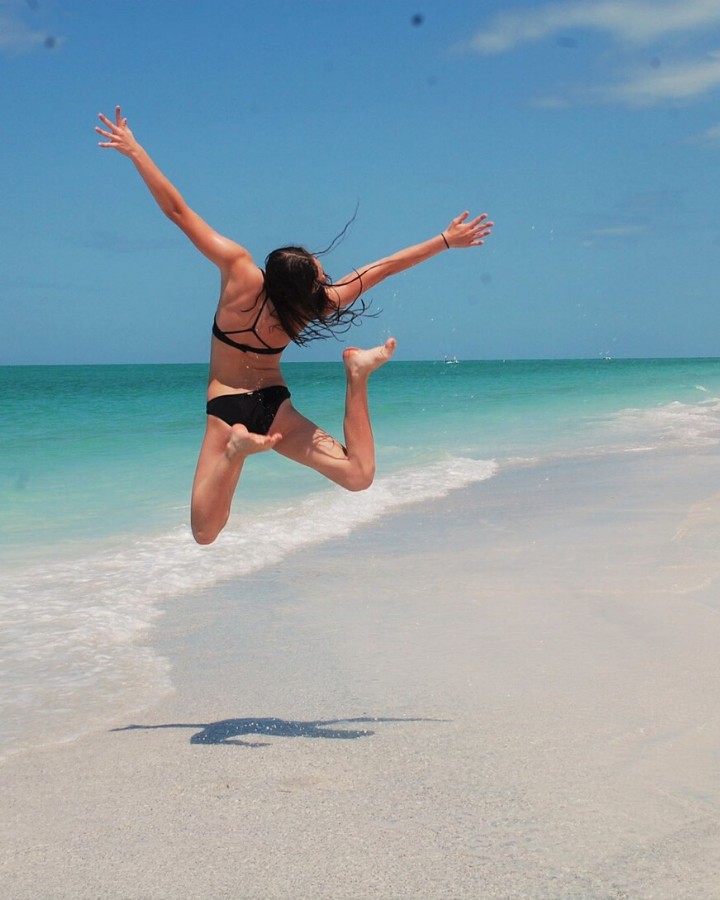 picture of a girl jumping on Anna Maria Island Beach