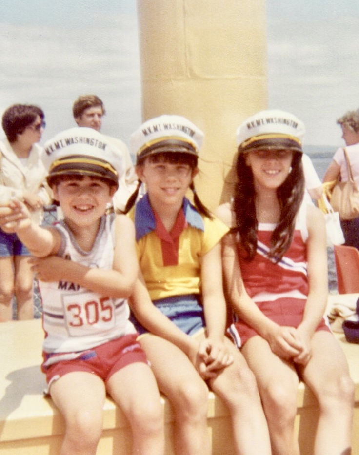 my siblings and I wearing summer clothes and captains hats on the Mount Washington 1980
