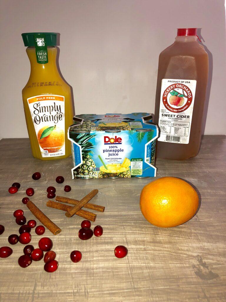 apple cider, orange juice, pineapple juice, fresh orange, fresh cranberries, cinnamon sticks