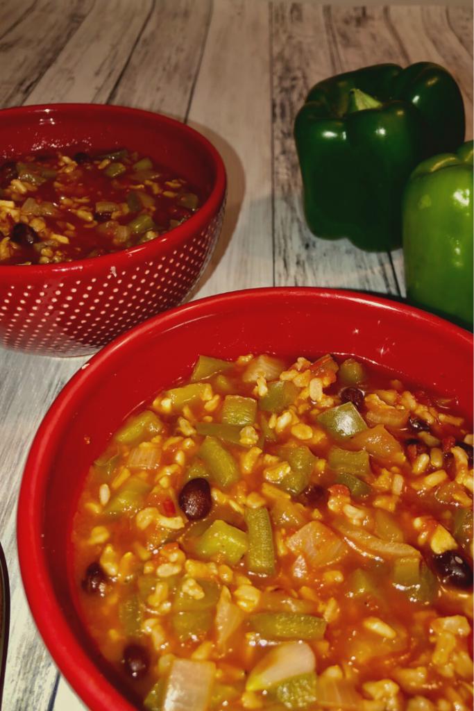 2 red bowls full of stuffed pepper soup