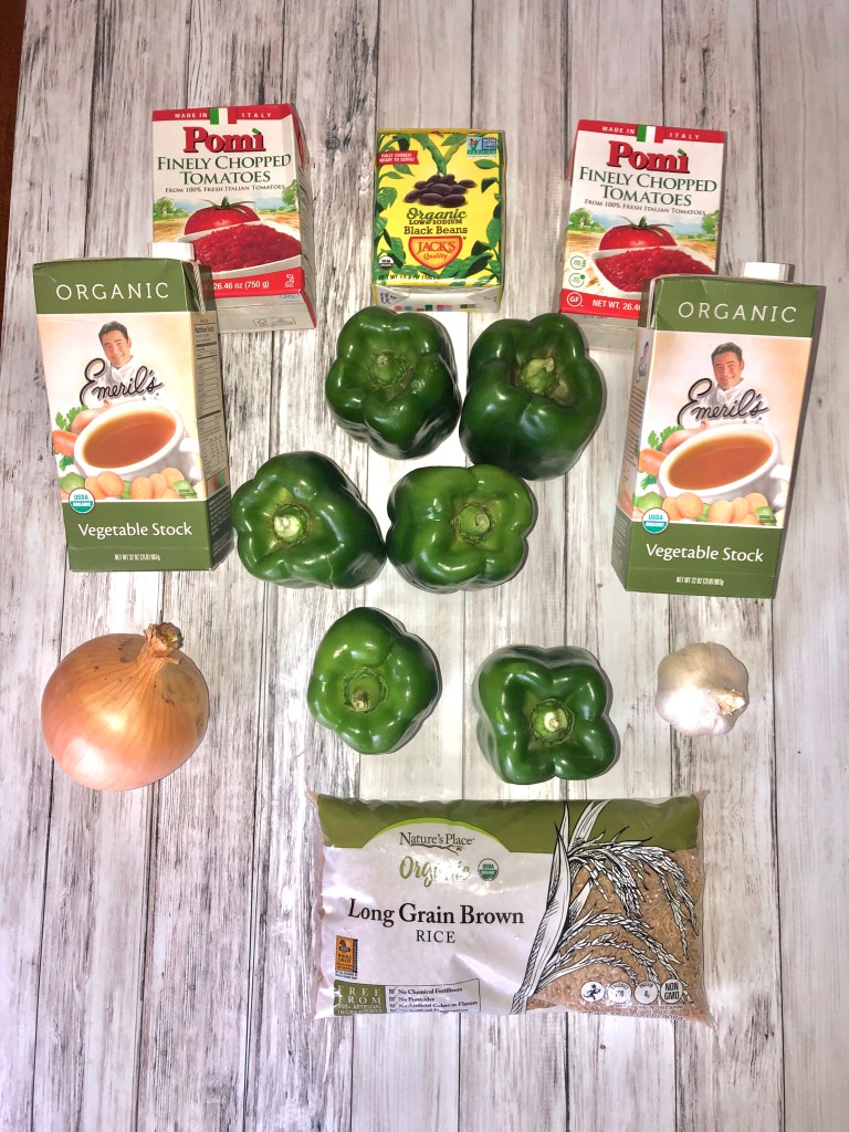 6 green peppers, 1 yellow onion, 1 head of garlic, cartons of vegetable stock, tomato, and black beans, bag of rice