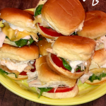 plate full of turkey sliders dripping with garlic aioli
