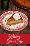slice of spice cake with a dollop of whipped cream on a festive plate