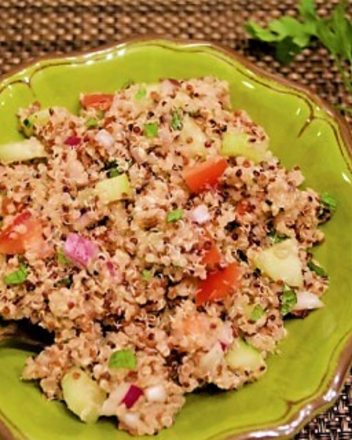 green bowl of quinoa salad