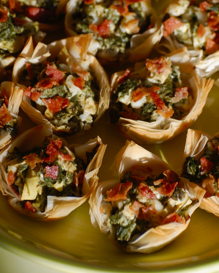 Spinach Artichoke Bites on a green plate
