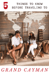 young couple sitting on wood chairs smiling at each other