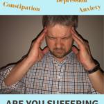 man holding his head with headache
