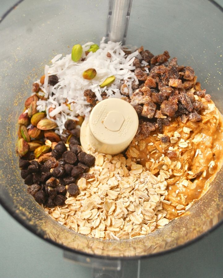 pistachios, oats, dates, peanut butter, dark chocolate, coconut, and flaxseed in food processor