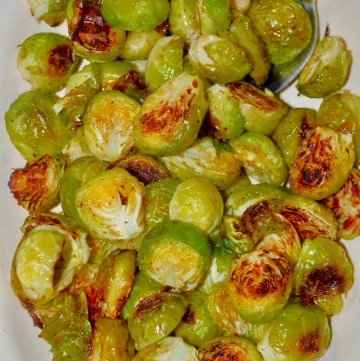 Bowl full of browned, halved, roasted Brussels Sprouts