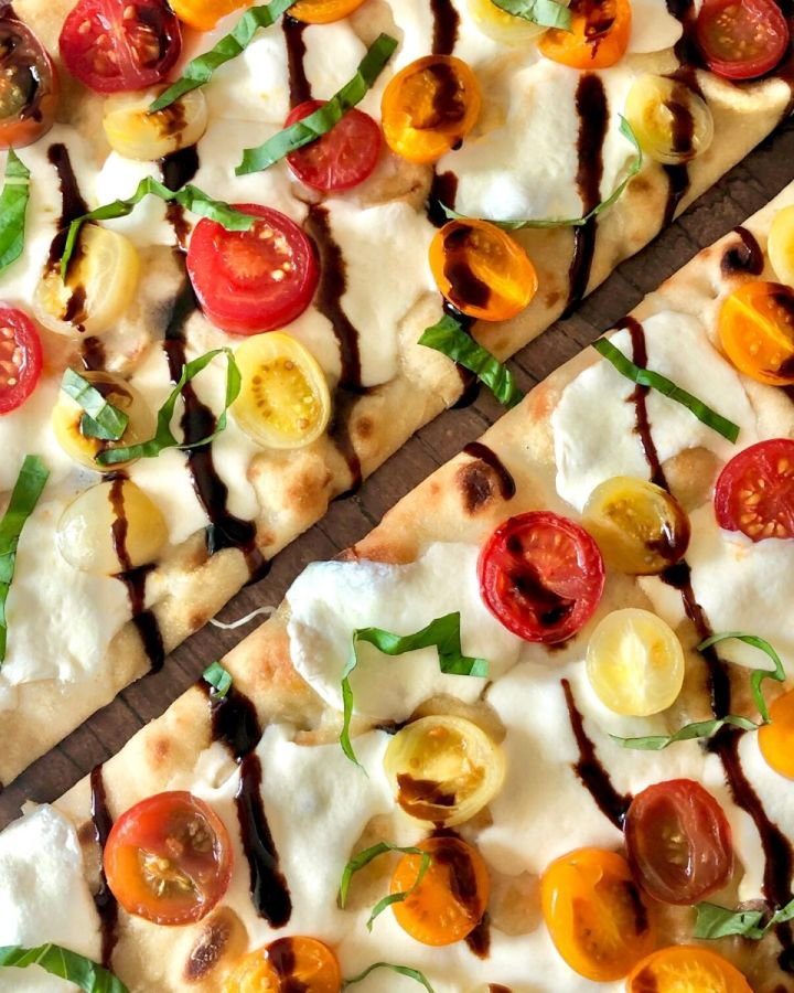 flatbread pizza with melted mozzarella, basil, drizzled with balsamic glaze