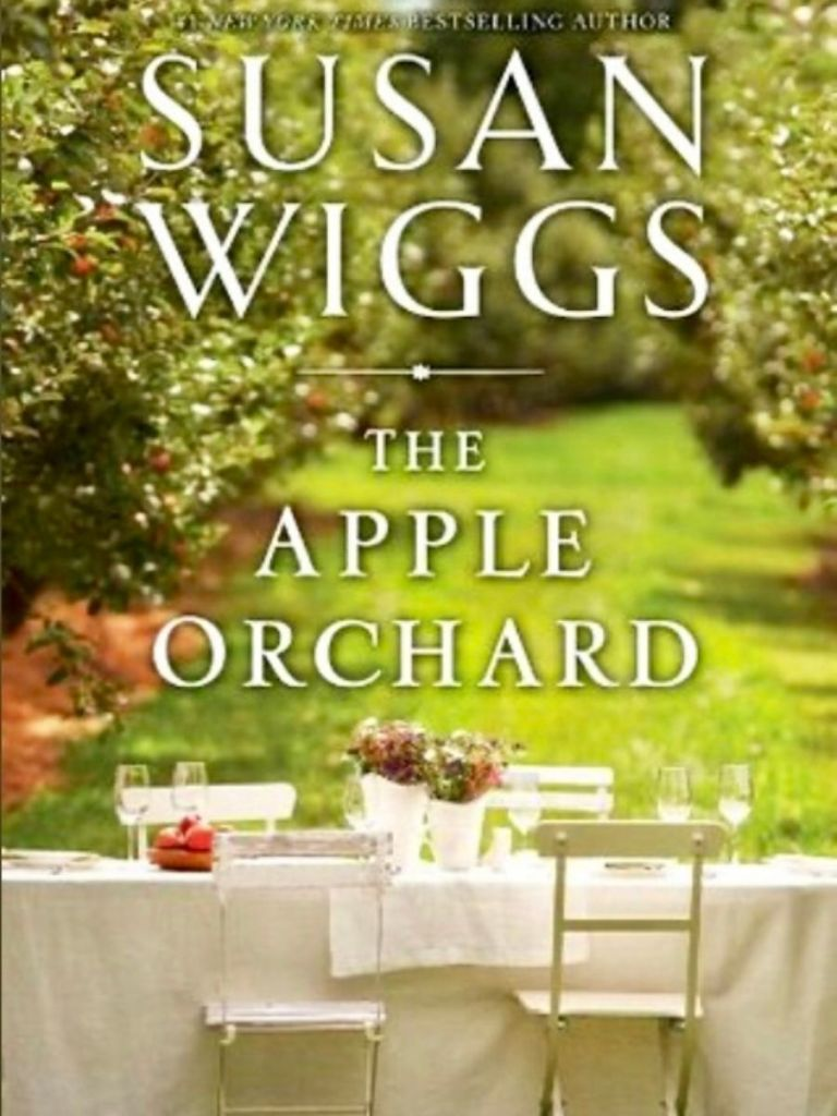 Cover of the book The Apple Orchard by Susan Wiggs - a table set with wine glasses out in the orchard.