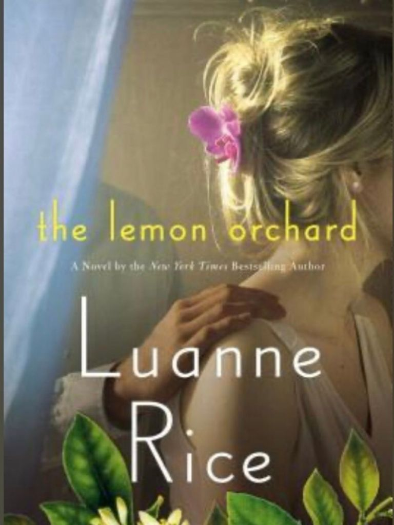 cover of the book the Lemon Orchard by luanne Rice - a women in a dress with a pink flower in her hair with a dark skinned man's hand on her shoulder