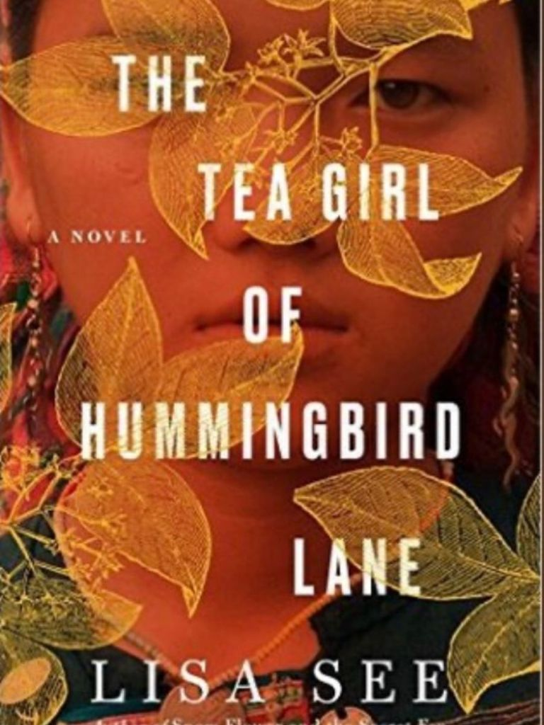 cover of the book The Tea Girl of Hummingbird Lane = a Chinese girl peeking between the leaves