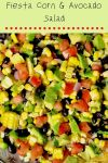 bowl full of corn, avocado, tomato, black beans, red onion, and cilantro