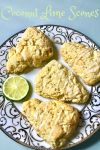 four glazed scones on an elegant plate garnished with a slice of lime