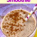 Smoothie in glass garnished with cinnamon with polka dot straw