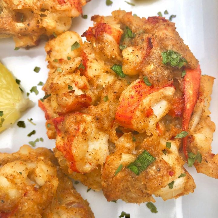 Lobster cakes garnished with parsley