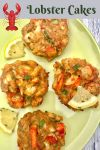 Plate of 4 lobster cakes garnished with lemon