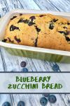 Blueberry zucchini bread in a green loaf pan