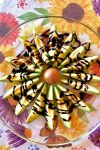 Avocado slices arranged around the pit to resemble a flower and drizzled with balsamic glaze