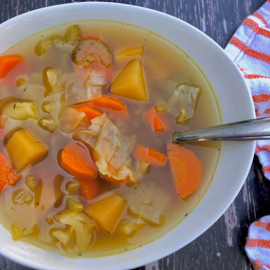 a bowl of Instant Pot vegetable soup with carrot, turnip and cabbage