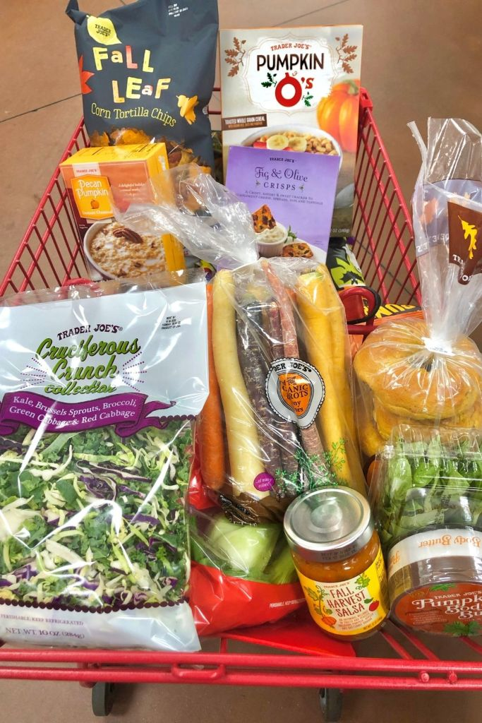 grocery cart full of fall products at Trader Joe's