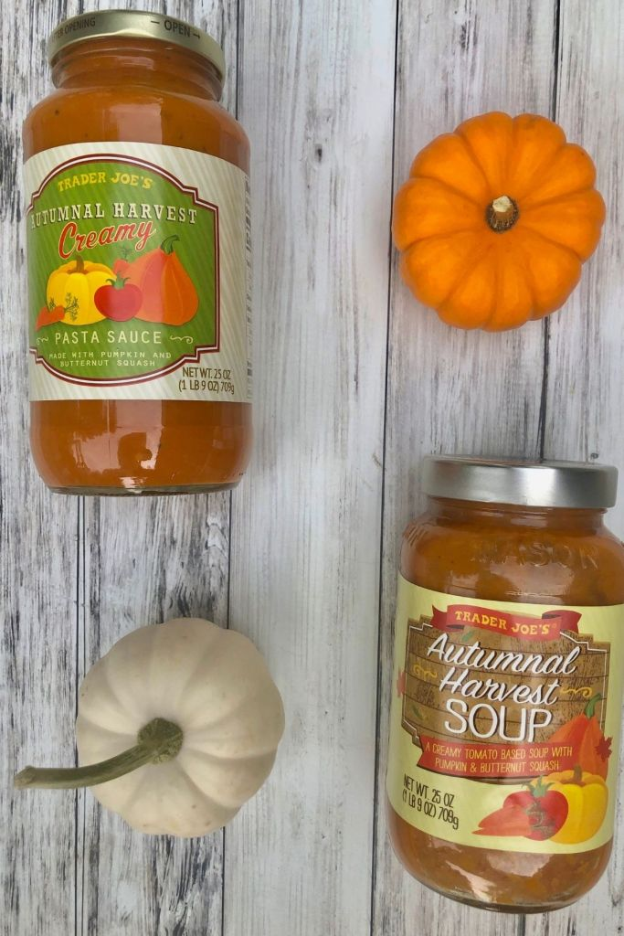 jar of autumn harvest pasta sauce, jar of autumn harvest soup with a small white pumpkin and small orange pumpkin