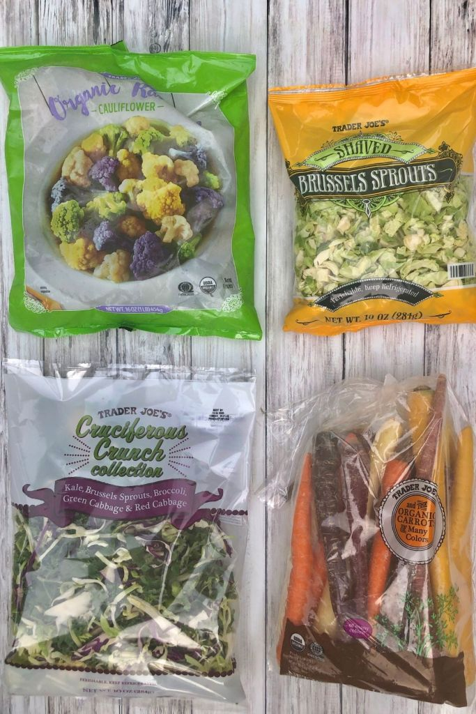 4 packages of veggies - rainbow cauliflower, shredded Brussells sprouts, kale mix, and rainbow carrots