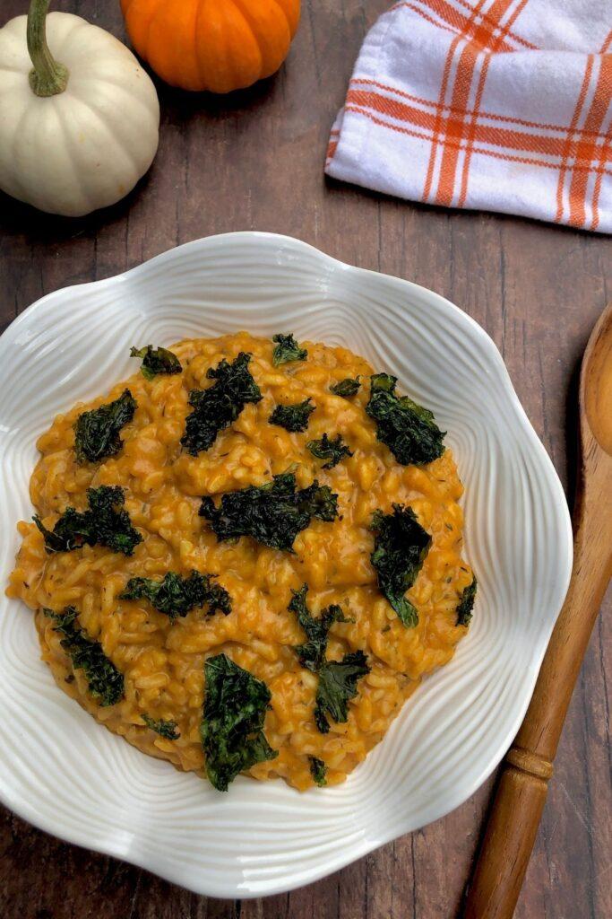 Pumpkin risotto in decorative white bowl