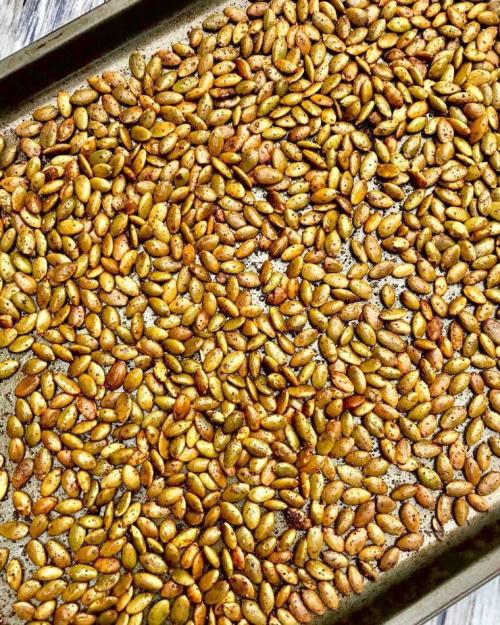a baking sheet full of roasted, spiced pepitas