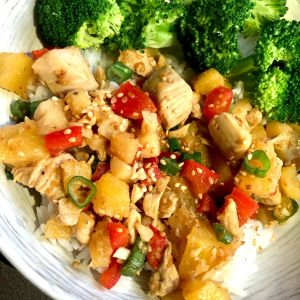 Pineapple chicken on a plate with broccoli