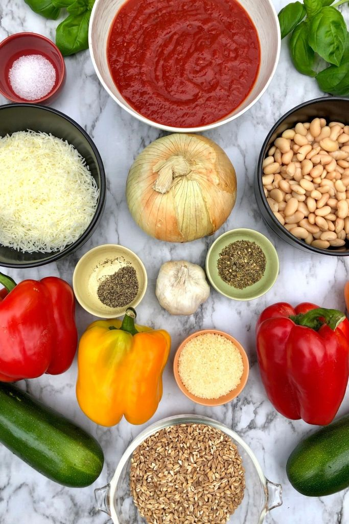 2 red peppers, 1 yellow pepper, 1 orange pepper, 2 zucchini, farro, beans, cheese, and spices