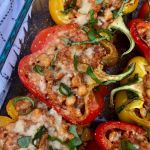 Rainbow stuffed peppers garnished with fresh parsley