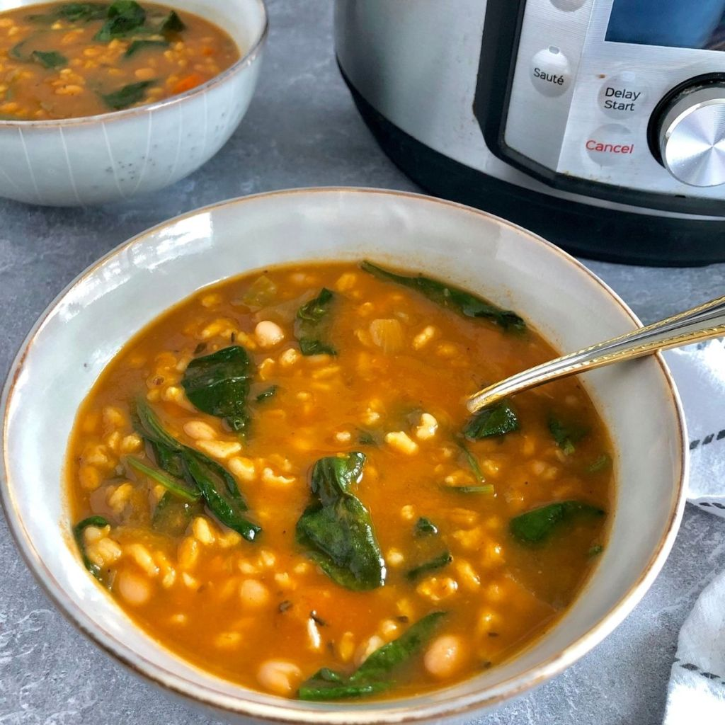 Bowls of Bean Barley Soup with Instant Pot to the side