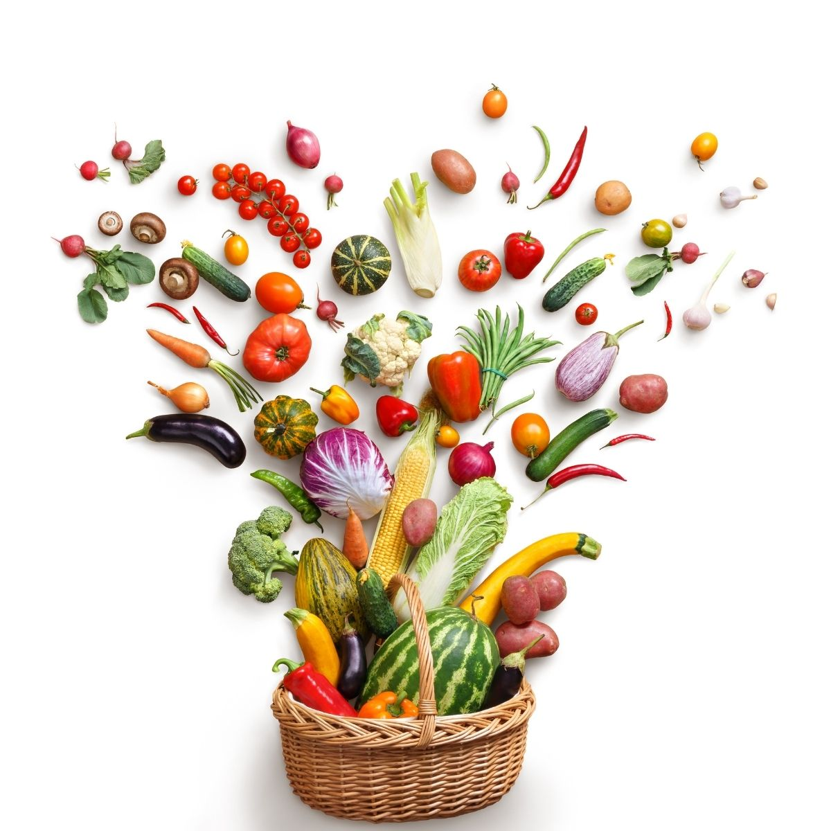 Fruits and vegetable spraying outward from a basket to resemble a bouquet