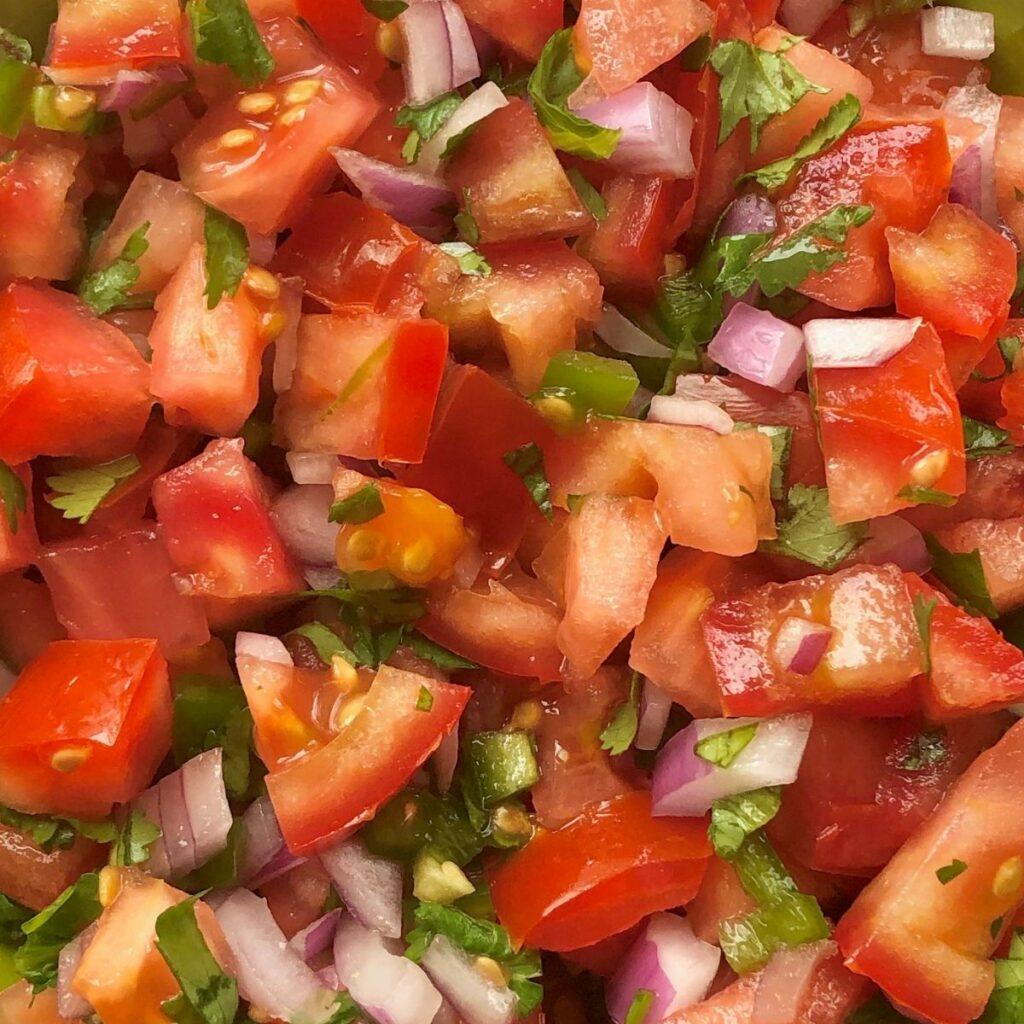 close up of pico de gallo with fresh tomato, red onion, cilantro, jalapeno