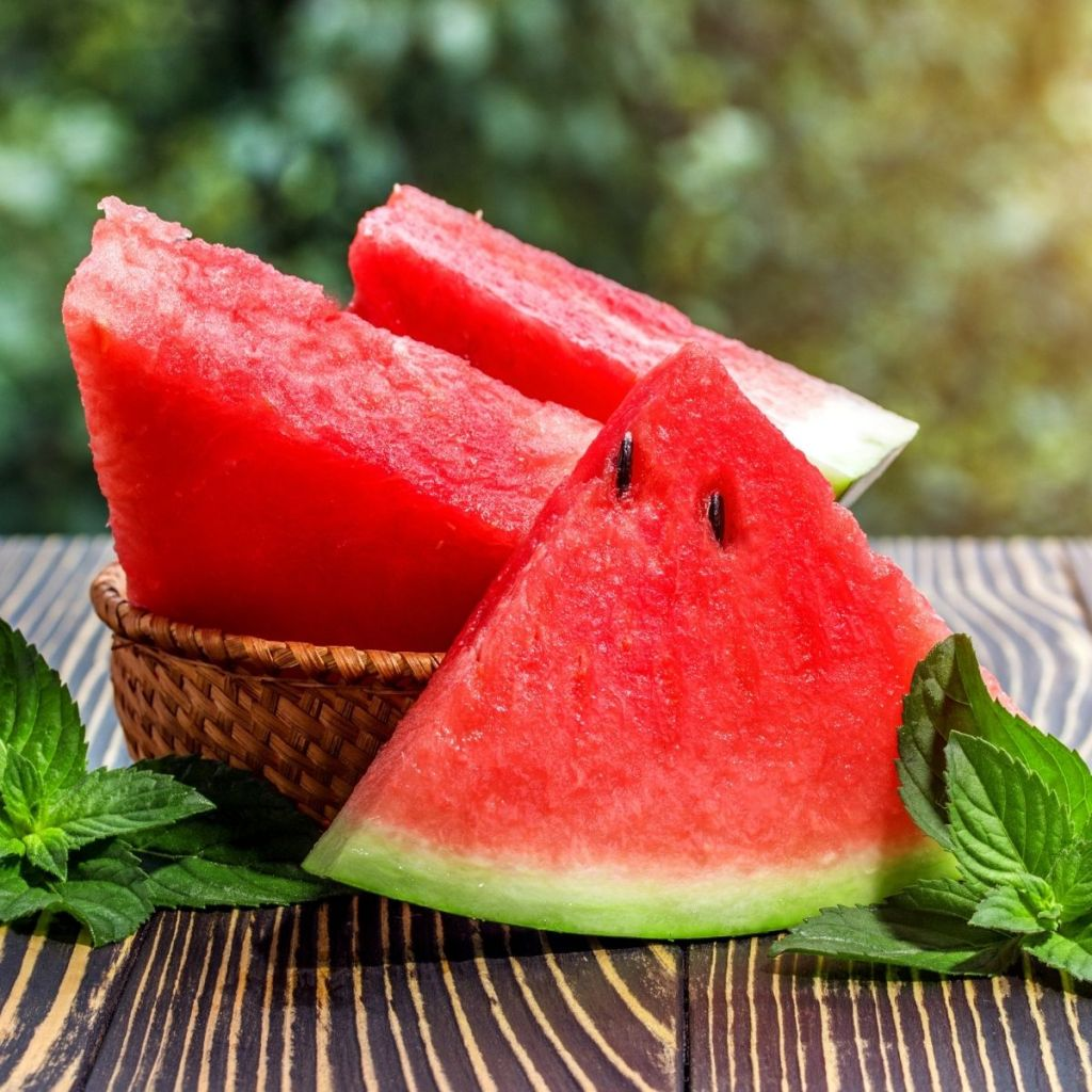 3 slices of fresh watermelon on a table