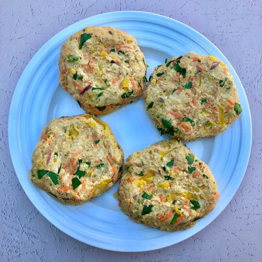 four formed chickpea patties on a plate