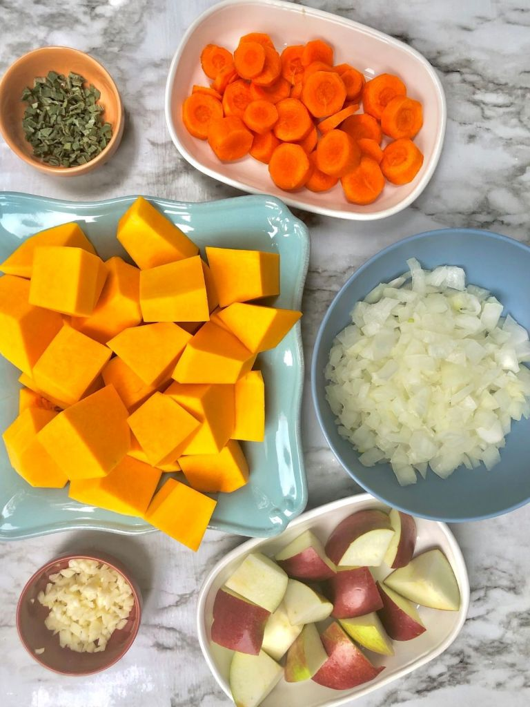 Cubed butternut squash and apple, sliced carrots, chopped onion, minced garlic, and finely chopped sage